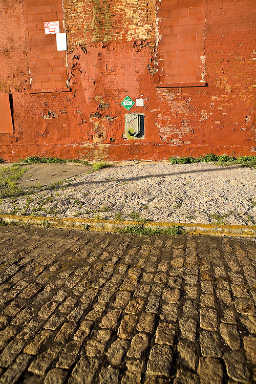 Close-up of a cobblestoned street and sidewalk on an empty street in Red Hook, Brooklyn, New York