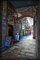 A view under the sheltered area across from the Ha'penny Bridge in Dublin that houses the Merchant's Arch Bar & Restaurant.