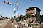 Mar. 13, 2011 - Kita-Ibaraki, Japan - Houses are shown destroyed along the street two days after the 8.9 magnitude earthquake struck followed by a tsunami that hit the north-eastern region. The death toll is currently unknown with casualties that may run well into the thousands.