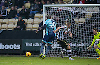 Adebayo Akinfenwa of Wycombe Wanderers scores his goal during the Sky Bet League 2 match between Notts County and Wycombe Wanderers at Meadow Lane, Nottingham, England on 10 December 2016. Photo by Andy Rowland.