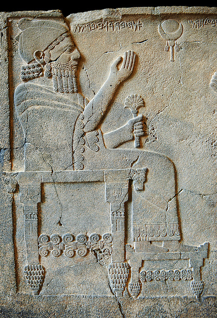 """Relief panels orthostat from northern part of the hall at the Palace of Sam 'al - Zincirli. On the throne sits the Prince Barrakib. Above his head each side of a crescent moon  are inscriptions in Aramaic """"I am Barrakib, son of Panammuwa"""" and the inscription """"My Lord of the Ba 'al of Harran"""" with symbols of the moon god. Neo Syro Hittite.  Basalt around 730 BC. Pergamon Museum, Berlin, inv no VA2817"""