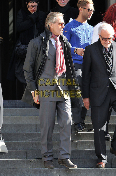 Jeremy Irons.Vidal Sassoon memorial service for legendary hairdresser who died in May 2012 following a battle with leukaemia. St Paul's Cathedral, London, England..October 12th, 2012.full length grey gray jacket pink scarf sunglasses shades smoking cigarette suit side profile .CAP/BF.©Bob Fidgeon/Capital Pictures.