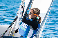 Michelle Frias, '21, works the sail as the Salve Regina Sailing Team practices in the Newport Harbor.