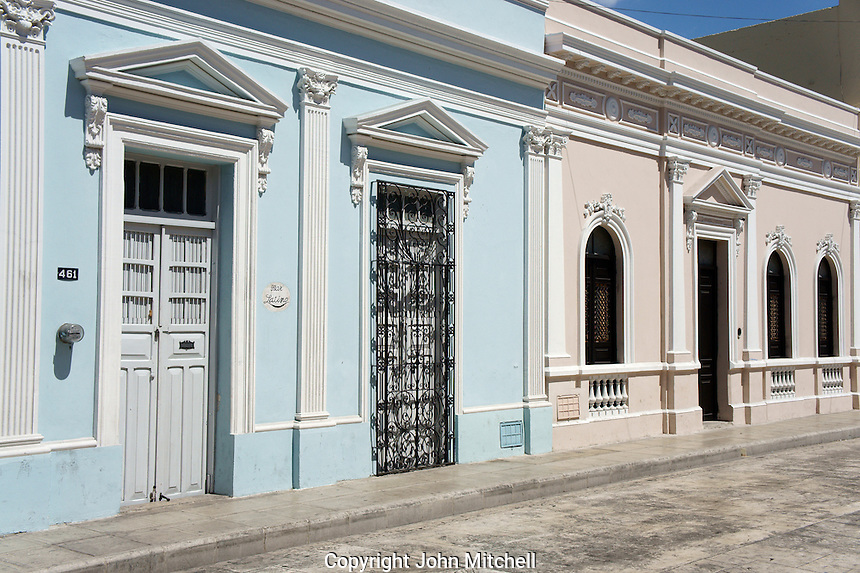 Neoclassical style facades of restored Spanish colonial houses, Merida, Yucatan, Mexico...