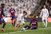 1st March 2020; Estadio Santiago Bernabeu, Madrid, Spain; La Liga Football, Real Madrid versus Club de Futbol Barcelona; Luka Modric (Real Madrid) breaks away from Samuel Umtiti (FC Barcelona)