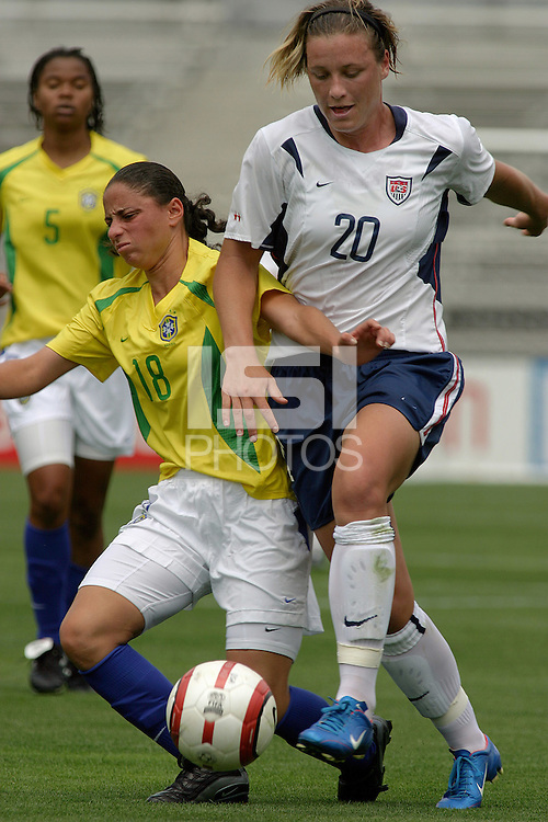 Abby Wambach(USA) v Janaina(Bra).US Women's National Team vs Brazil at Legion Field in Birmingham, Alabama.