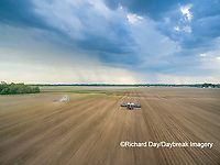 Farmer planting corn ahead of a thunderstorm-aerial Marion Co. IL,
