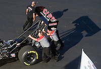 Apr. 13, 2012; Concord, NC, USA: NHRA crew members for top fuel dragster driver Steve Torrence push his car out ready to be towed to the staging lanes during qualifying for the Four Wide Nationals at zMax Dragway. Mandatory Credit: Mark J. Rebilas-