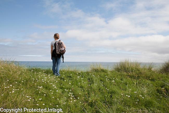 Female Treker on the Isle of Sanday, Orkney Islands, Scotland