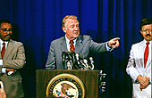 United States Attorney General Edwin Meese, III, center, conducts a press conference to discuss the Department of Defense scandal and the Teamsters case at the US Department of Justice in Washington, DC on June 28, 1988.<br /> Credit: Ron Sachs / CNP
