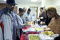 A Thanksgiving potluck organized by social workers for the residents of The Gen Chauncey M. Hooper Towers, that hosts the Harlem Internet Computer Access program taught by instructor Merle Bush in Harlem, Manhattan, NY, USA on November 16, 2011.