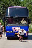 Tomi Lotta of Finland competes in bus pulling during the Giants Live Strongman Competition in Budapest, Hungary on June 17, 2012. ATTILA VOLGYI