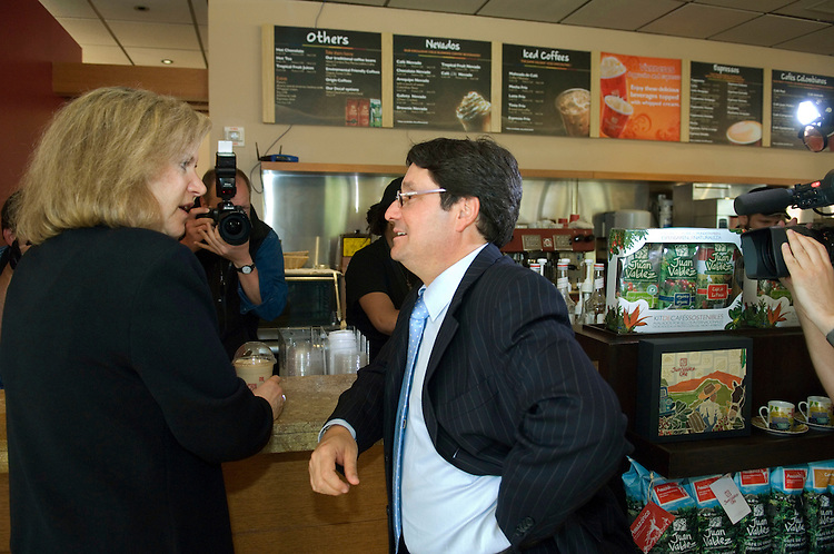 WASHINGTON, DC - April 18: United States Trade Representative Susan C. Schwab and Colombian Vice President Francisco Santos Calderón order coffee during a photo op at Juan Valdez Coffee Company, on F Street NW, to highlight the Colombian Free Trade Agreement. The shop sells Colombian coffee. Colombia's top officials meanwhile have received no assurances that the pending free-trade agreement will come up for a vote this year, following last week's House vote to suspend action on the pact's implementing legislation. Calderón, who is in Washington to meet with business groups to garner support for the trade deal, said House Speaker Nancy Pelosi, D-Calif., has not made any promises to Colombia that Congress will vote on the trade pact (HR 5724) this year. (Photo by Scott J. Ferrell/Congressional Quarterly)