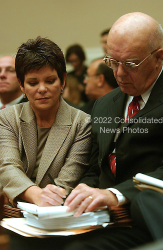 Washington, D.C. - September 28, 2006 -- Patricia Dunn, former Chairman of the Board, Hewlett-Packard Company, left, communicates by note to her attorney, Jim Bresnahan, right, prior to testifying before the United States House Subcommittee on Oversight and Investigations hearing on &quot; Hewlett-Packard's Pretexting Scandal&quot; in Washington, D.C. on September 28, 2006.<br /> Credit: Ron Sachs / CNP<br /> [No New York Metro or other Newspapers within a 75 mile radius of New York City]