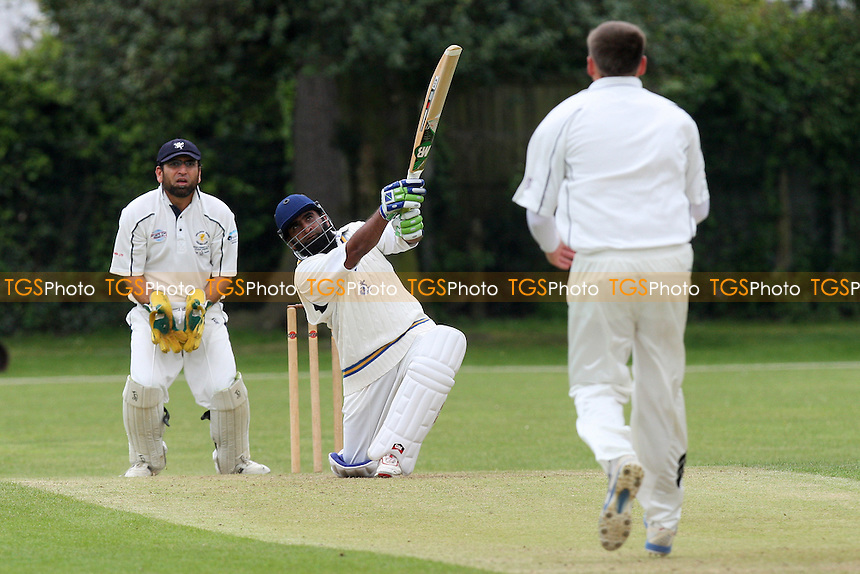 S Rahman sends a Cook delivery to the boundary  - Upminster CC vs Ardleigh Green CC - National Club Championship 1st Round - 16/05/10 - MANDATORY CREDIT: Gavin Ellis/TGSPHOTO - Self billing applies where appropriate - Tel: 0845 094 6026