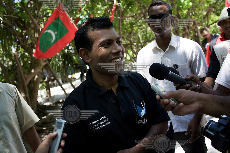President Mohammed Nasheed being interviewed after signing a document calling on all countries to cut down their carbon dioxide emissions. 20 feet below the surface and dressed in scuba gear, Nasheed and his government ministers had held a meeting of the Maldives' Cabinet to highlight the threat global warming poses to the lowest-lying nation on earth.
