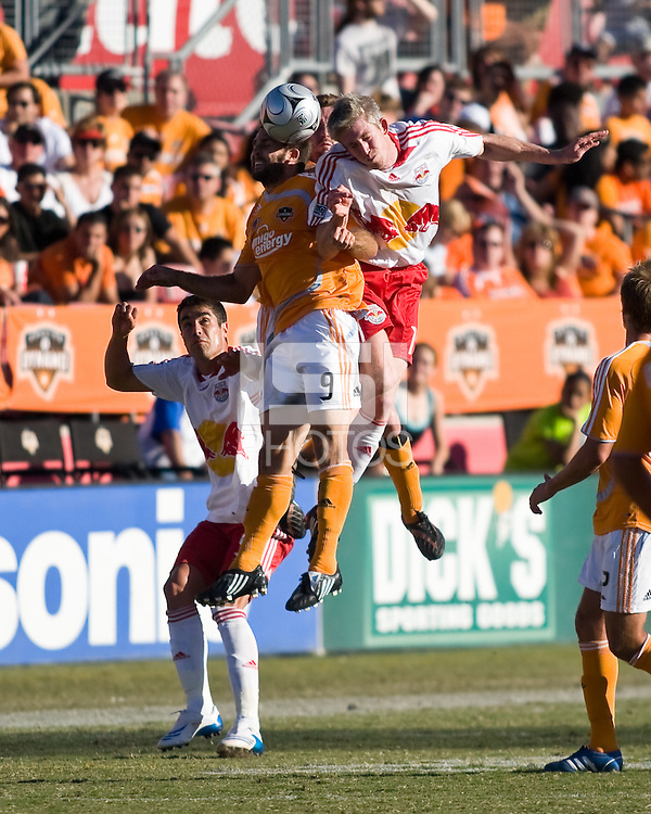 Houston Dynamo midfielder Brian Mullan (9) and New York Red Bulls forward John Wolyniec (15) go up for the header.  New York Red Bulls defeated Houston Dynamo 3-0 for an aggregate  score of 4-1 over Houston Dynamo   at Robertson Stadium in Houston, TX on November 9, 2008 in the second leg of the Western Conference semifinals.  Photo by Wendy Larsen/isiphotos.com