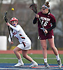 Marisa Misuraca #4 of MacArthur, and Jamie Maddaluno #16 of Mepham battle for control of a faceoff during a Nassau County varsity girls lacrosse game against Mepham at MacArthur High School on Monday, March 20, 2017. MacArthur won by a score of 13-6.