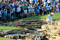 Tommy Fleetwood (ENG) in action on the 18th fairway during the final round of the DP World Championship, Earth Course, Jumeirah Golf Estates, Dubai, UAE. 24/11/2019<br /> Picture: Golffile | Phil INGLIS<br /> <br /> <br /> All photo usage must carry mandatory copyright credit (© Golffile | Phil INGLIS)
