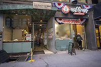 The Mandoo Bar, left, and Daheen Wang Mandoo, next door to each other in Koreatown on West 32nd street in New York on Thursday, January 24, 2013. (© Richard B. Levine)