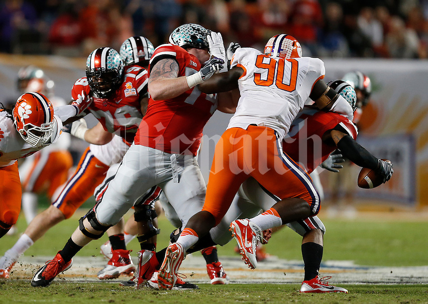 Clemson Tigers defensive end Shaq Lawson (90) sacks Ohio State Buckeyes quarterback Braxton Miller (5) in the first quarter of the Discover Orange Bowl between Ohio State and Clemson at Sun Life Stadium in Miami Gardens, Florida, Friday night, January 3, 2014. As of half time the Ohio State Buckeyes led the Clemson Tigers 22 - 20.(The Columbus Dispatch / Eamon Queeney)
