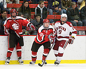 George Hughes (St. Lawrence - 15), Matt Raley (St. Lawrence - 52), Alex Killorn (Harvard - 19) - The St. Lawrence University Saints defeated the Harvard University Crimson 3-2 on Friday, November 20, 2009, at the Bright Hockey Center in Cambridge, Massachusetts.