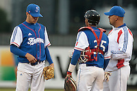 17 August 2010: Starting pitcher Joris Navarro of Team France talks to pitching coach Keino Perez, next to Andy Paz Garriga, as he pitches against Czech Republic during the Czech Republic 4-3 win over France, at the 2010 European Championship, under 21, in Brno, Czech Republic.
