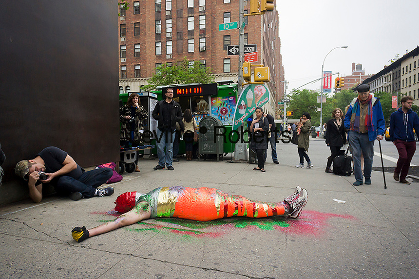"""An unnamed performance artist """"performs"""" on West 23rd Street in the trendy West Chelsea art gallery district on Saturday, May 5, 2012. The galleries of West 26th Street organized a block fair at the same time as Frieze and Pulse art fairs were taking place in the city. The galleries stayed open late and provided goodie bags as well as arranging for a number of food trucks to park on the street. (© Richard B. Levine)"""