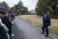 Police control well-wishers at the Imperial Palace to celebrate the 85th birthday of Emperor Akihito of Japan. The Emperor, who is the son of Japan's wartime leader, Emperor Hirohito, gave a speech to mark his last birthday before his upcoming abdication, saying he felt relief that his reign was coming to an end without having seen his country at war again and that it was important to continue to educate young people about japan's wartime past. Imperial Palace, Tokyo, Japan. Sunday December 23rd 2018