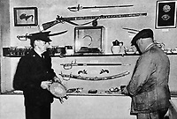 BNPS.co.uk (01202 558833)Pic: IllustratedLondonNews<br /> <br /> The empty case ath the National Maritime Museum on 11 June 1951, with bemused wardens looking at the empty case.<br /> <br /> Brought back to life - An authors research into the audacious heist that stole Lord Nelson's most valuable jewel has led to the famous treasure being recreated in exact detail.<br /> <br /> The diamond Chelengk became one of the most iconic jewels in British history after he was presented it by a grateful Sultan Selim III of Turkey after his victory at the Battle of the Nile in 1798.<br /> <br /> Nelsons family sold the gem at auction in 1895, and it eventually found its way to the newly opened National Maritime Museum in Greenwich where it was a star exhibit. <br /> <br /> In 1951 the jewel was stolen in a daring raid by infamous cat-burglar George Chatham and lost forever.<br /> <br /> Now author Martyn Downer has commissioned an exact replica to coincide with the launch of his new book 'Nelson's Lost Jewel' - along with a new tricorn hat from Lock &amp; Co, Nelsons hat makers in the heart of London who are still operating to this day.<br /> <br /> Martyn recently returned the diamond Chelengk, worth hundreds of thousands of pounds, to Nelson's day cabin on HMS Victory in Portsmouth where the National Museum of the Royal Navy will display it...under very tight security.