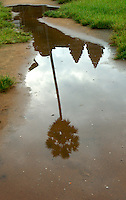CAMBODIA 2007,SIAM REAP, reflectio of Angkor Wat in a pool of water after a heavy rain shower during the Monsoon season