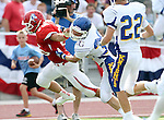 SIOUX FALLS, SD - SEPTEMBER 7:  Matt Wagner #36 from Lincoln pushes off the defender Eion Donelan #30 from O'Gorman in the second quarter of their game at the 2013 Presidents Bowl at Howard Wood Field. (Photo by Dave Eggen/Inertia)