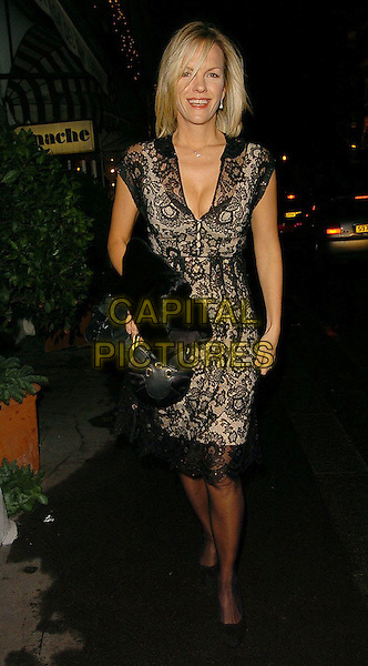 ELIZABETH MURDOCH.Project Catwalk Reality TV Launch held at San Lorenzo Restaurant, London..UK, United Kingdom..6th December 2005.Ref: CAN.full length black lace dress plunging neckline cleavage.www.capitalpictures.com.sales@capitalpictures.com.©Capital Pictures