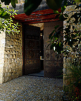 The fortress-like double doors lead to the property's central courtyard