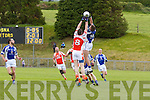 Pictured on Sunday for the Castleisland Mart Junior County Championship Quarter-Final, Brosna V Templenoe in Pairc na Feile Brosna. <br /> Templenoe's Adrian Spillane just beats Brosna's Dave Curtin to the ball.