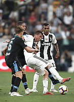 Calcio, Serie A: Juventus - Lazio, Torino, Allianz Stadium, 25 agosto, 2018.<br /> Juventus' Mario Mandzukic (r) in action with Lazio's Adam Marusic (c) and Lucas Leiva (l) during the Italian Serie A football match between Juventus and Lazio at Torino's Allianz stadium, August 25, 2018.<br /> UPDATE IMAGES PRESS/Isabella Bonotto
