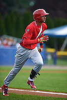 Williamsport Crosscutters outfielder Jose Pujols (23) runs to first during a game against the Batavia Muckdogs on August 29, 2015 at Dwyer Stadium in Batavia, New York.  Williamsport defeated Batavia 7-3.  (Mike Janes/Four Seam Images)