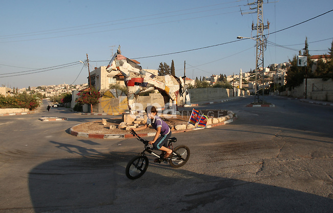 A Palestinian boy rides the bicycle inside the Jenin refugee camp West Bank city of Jenin on Sep. 12, 2011. Photo by Wagdi Eshtayah