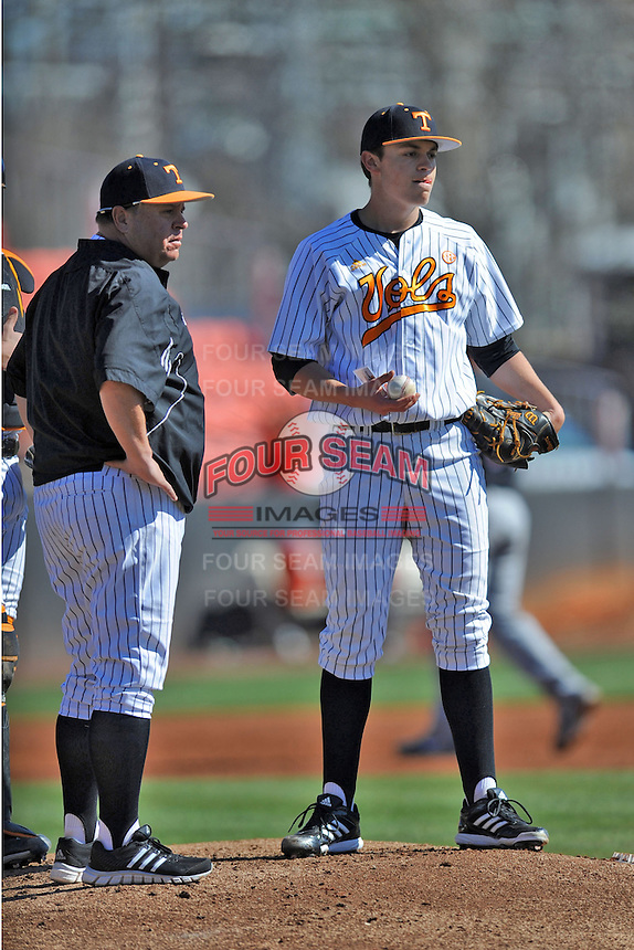 Tennessee Volunteers head coach Dave Serrano #12 relieves starting pitcher Kyle Serrano #11 during a game against the UNLV Runnin' Rebels at Lindsey Nelson Stadium on February 22, 2014 in Knoxville, Tennessee. The Volunteers defeated the Rebels 5-4. (Tony Farlow/Four Seam Images)