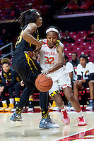 College Park, MD - DEC 6, 2016: Maryland Terrapins guard Shatori Walker-Kimbrough (32) drives by Towson Tigers center Daijha Thomas (33) on her way to a lay up during game between Towson and Maryland at XFINITY Center in College Park, MD. The Terps defeated the Tigers 97-63. (Photo by Phil Peters/Media Images International)