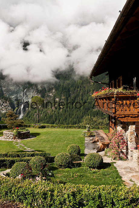 The simple garden around the chalet has breathtaking views of the surrounding mountains