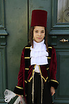The Synagogue of the Premishlan congregation on Purim holiday, Hasidic boy in costume
