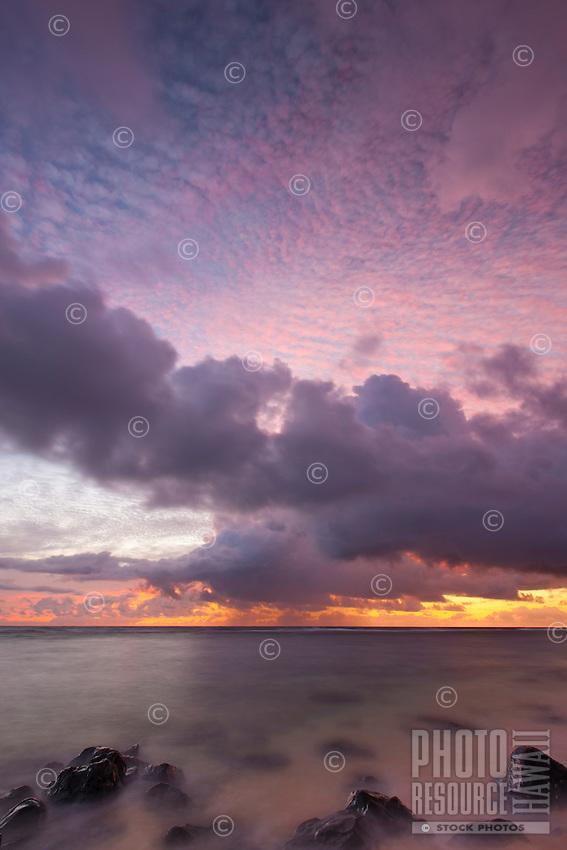 A brilliantly colored sunrise at Larsen's Beach, Kilauea, Kauai