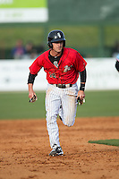 Grant Massey (18) of the Kannapolis Intimidators hustles towards third base against the Hickory Crawdads at Kannapolis Intimidators Stadium on April 10, 2016 in Kannapolis, North Carolina.  The Intimidators defeated the Crawdads 10-3.  (Brian Westerholt/Four Seam Images)