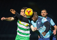 Adebayo Akinfenwa of Wycombe Wanderers & Matthew Dolan of Yeovil Town in action during the Sky Bet League 2 match between Wycombe Wanderers and Yeovil Town at Adams Park, High Wycombe, England on 14 January 2017. Photo by Andy Rowland / PRiME Media Images.