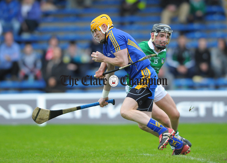 Patrick Kelly of Clare in action against Sean Tobin of Limerick during their game at Semple Stadium. Photograph by John Kelly.