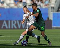 GRENOBLE, FRANCE - JUNE 22: Rasheedat Ajibade #15 dribbles as Klara Buehl #19 defends during a game between Nigeria and Germany at Stade des Alpes on June 22, 2019 in Grenoble, France.