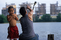 Oumansour Si Mohamed and his son, Hameza, spend the morning fishing on Town Lake across from the Holly Street Power Plant.