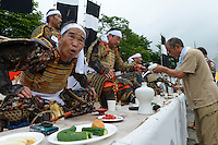 Participants eating and drinking during the Somanomaoi Festival, Minami-soma City, Fukushima Prefecture, Japan, July 27, 2013. During the four-day-long Somanomaoi Festival members of old samurai families ride horseback through the town in traditional armour.  They also take conduct ceremonies at local shrines, take part in horse races, and compete on horseback to catch a flag launched into the air by fireworks.