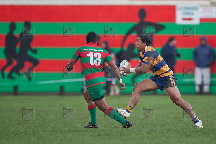 Bundellu Aki looks to step past Sio Petelo. Counties Manukau Premier Club Rugby Semi Final game between Waiuku and Patumahoe, played at Waiuku on Saturday June 25th 2011. Patumahoe won 23 - 14 and will meet Pukekohe in the McNamara Cup Premier final next week at Bayer Growers Stadium.